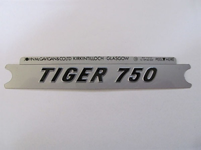 60-7055 Tiger 750 Side Cover Badge - Black/Silver