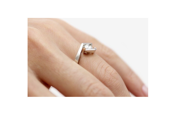 Croft Brilliant cut modern platinum diamond ring on hand