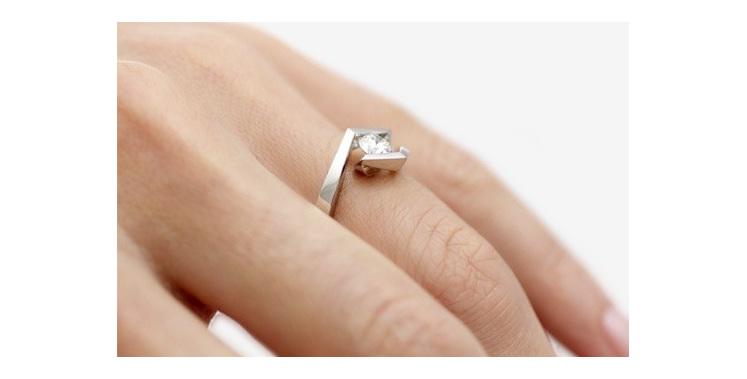 Croft Brilliant cut modern platinum diamond ring on hand