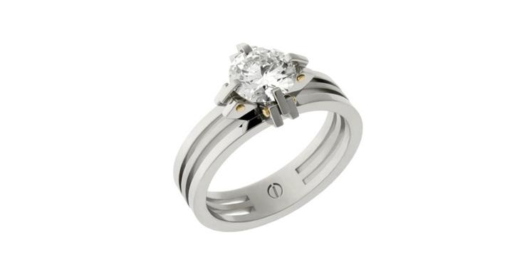 Designer claw setting platinum and gold round brilliant diamond engagement ring