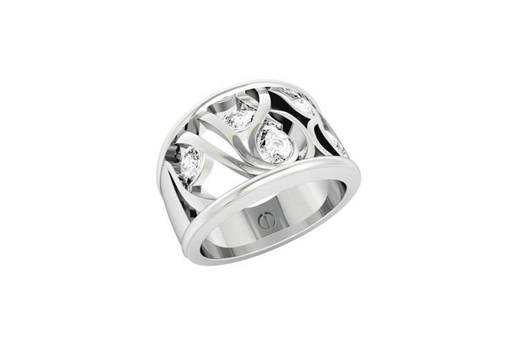 Designer multi stone pear shaped diamond platinum engagement ring