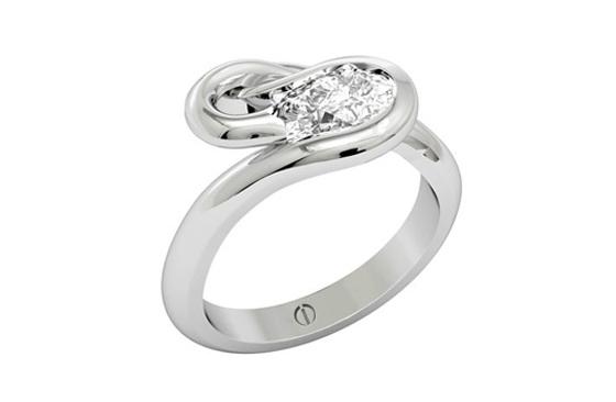 Designer pear shaped diamond flowing platinum engagement ring