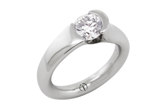 Designer round brilliant diamond tension set platinum engagement ring