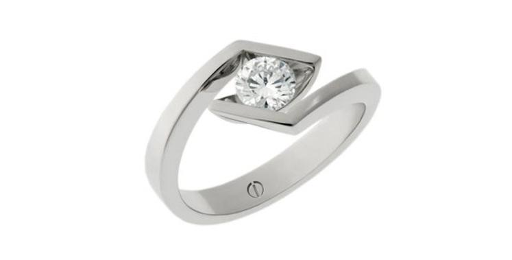 Designer round diamond platinum crossover engagement ring