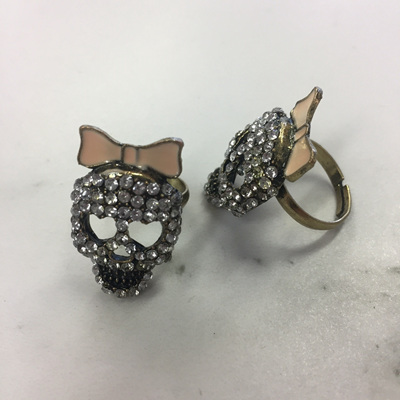 Rose and Thorn Bow Skull Ring