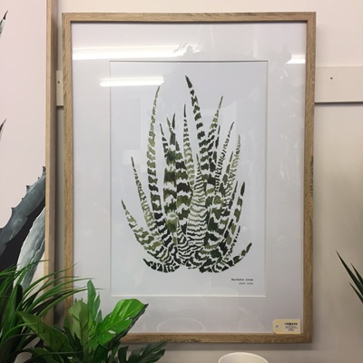Tamaya Framed Glass Print